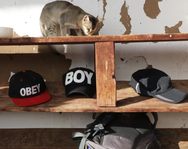 Shelves outside the temple to put forbidden things. I thought it was humerous--obey + boy hats at a monastic place