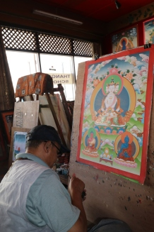 Thangka painting requires a month or longer with dedication to every tiny detail