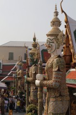 Protective demons facing the temple with the Emerald Buddha