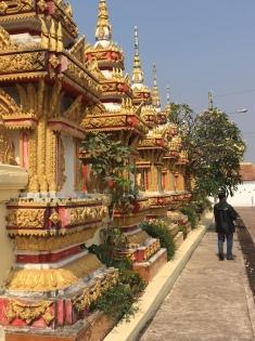 Memorial Stupas surrounding Buddha statue