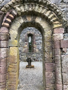 unusual entry to smaller chapel with an ancient cross found underwater and returned here.