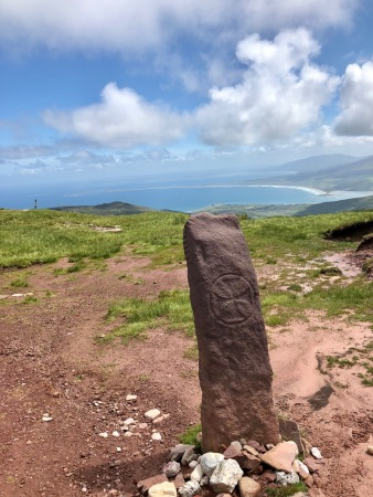 At the summit--ancient stone with runic writing on side but early christian cross etched on the front